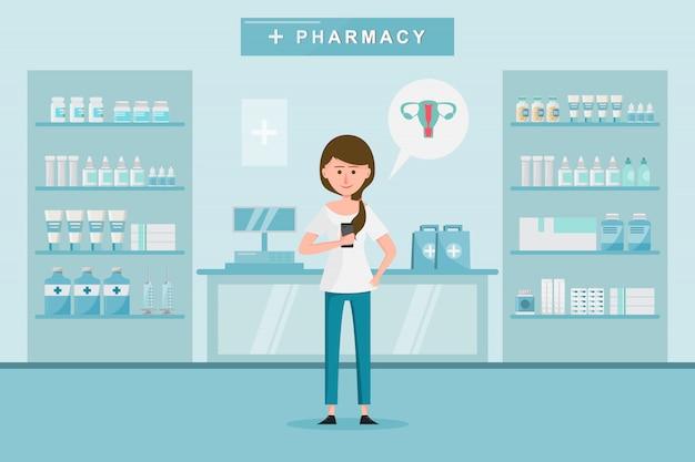 Farmacia con mujer compra drogas en la farmacia.