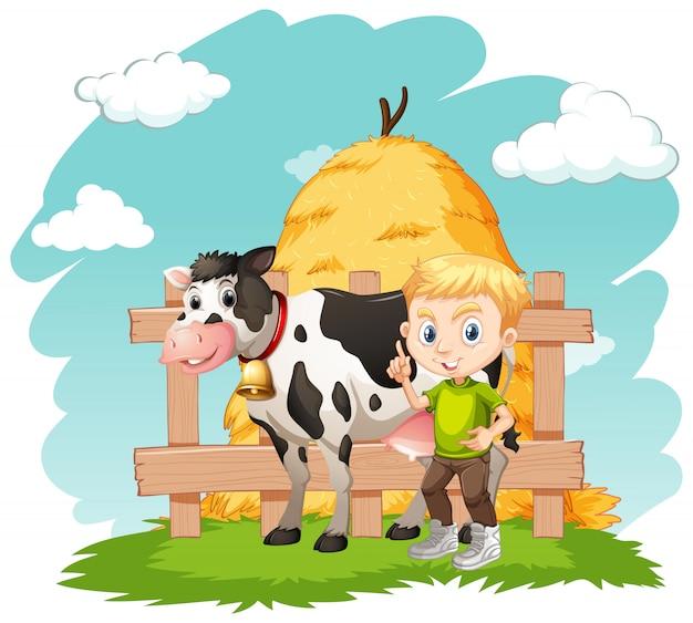 Farmboy y pequeña vaca en la granja