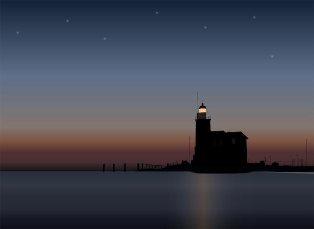 Faro con amanecer en la noche