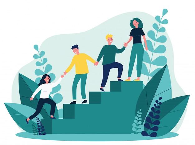 Felices empleados jóvenes que se apoyan y se ayudan mutuamente