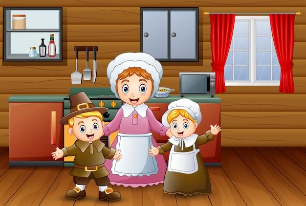 Felices los niños y la madre en la cocina.