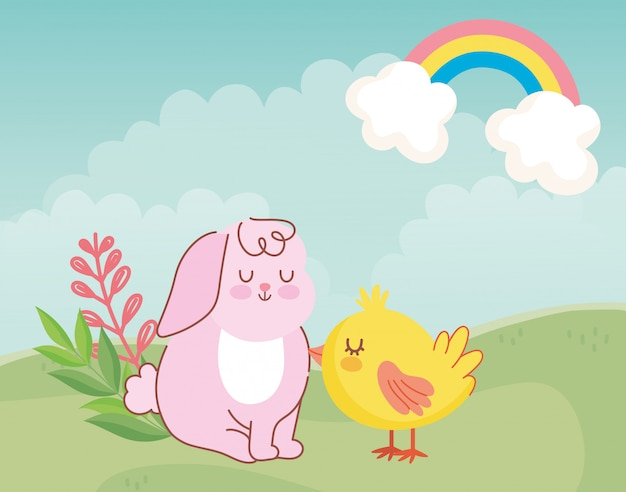Felices pascuas, lindo conejo y pollo sentado en una pradera