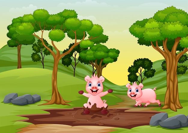 Felices sonrientes cerdos juegan en el barro