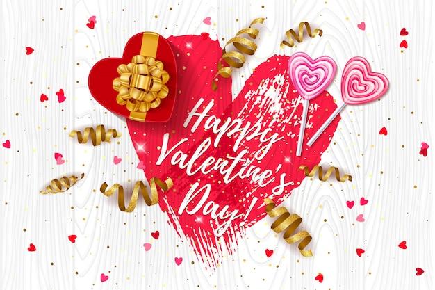 Feliz amor de san valentín con corazón, caja de regalo y serpentina dorada.