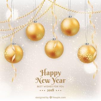 Feliz año nuevo 2018 en dorado con bolas de navidad