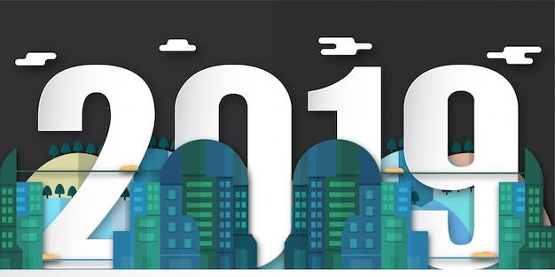 Feliz año nuevo 2019 decoración por la noche con ciudad urbana en papel cortado y artesanía digital.
