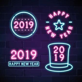 Feliz año nuevo 2019 letrero de neón vector conjunto