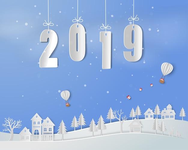 Feliz año nuevo 2019 sobre fondo de arte de papel