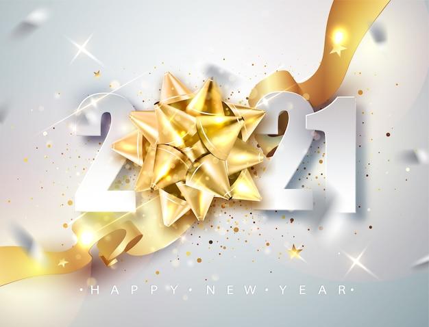 Feliz año nuevo 2021 elegante tarjeta de felicitación con cinta de regalo dorada.