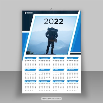 Feliz año nuevo 2022 plantilla de diseño de calendario de pared de negocios