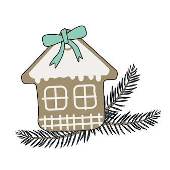 Feliz año nuevo casa de pan de jengibre con glaseado y lazo azul y rama de árbol de navidad. elemento decorativo festivo para el diseño y dulces para las vacaciones.