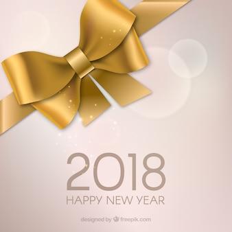 Feliz año nuevo con lazo de regalo dorado