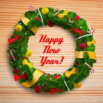 Feliz año nuevo corona decorada en mesa de madera