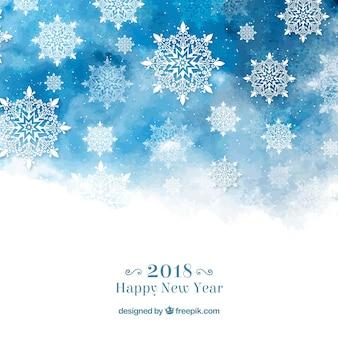 Feliz año nuevo fondo con copos de nieve en acuarela azul