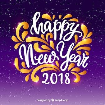Feliz año nuevo en letras caligráficas sobre un fondo morado