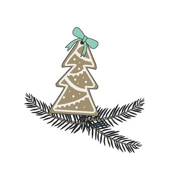 Feliz año nuevo pan de jengibre con glaseado en forma de abeto y un lazo rojo y rama de árbol de navidad. elemento decorativo festivo para el diseño de navidad y dulces para las vacaciones.