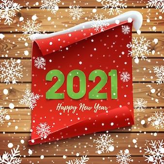 Feliz año nuevo tarjeta de felicitación. bandera curva roja sobre tablas de madera con nieve y copos de nieve.