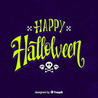 Feliz caligrafía de halloween con calaveras