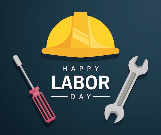 Feliz celebración del día del trabajo con casco y herramientas