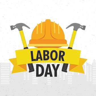Feliz celebración del día del trabajo con casco y letras