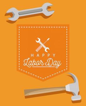 Feliz celebración del día del trabajo con llave y martillo