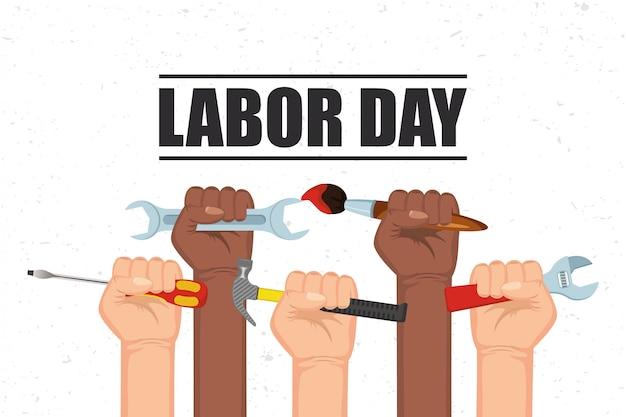 Feliz celebración del día del trabajo con manos levantando herramientas