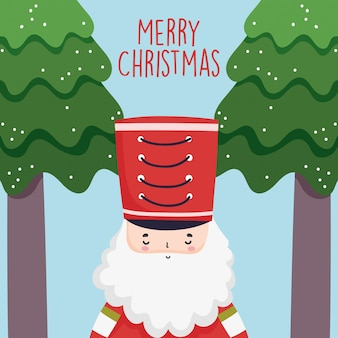 Feliz celebración de navidad lindo soldado cascanueces con sombrero y árboles