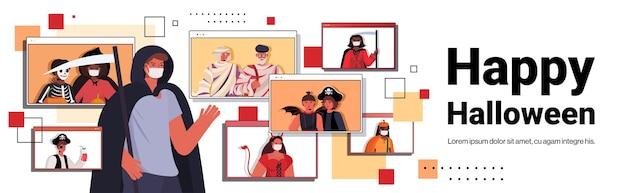 Feliz celebración navideña de halloween concepto mezclar personas de raza en disfraces discutiendo con amigos durante la videollamada web brwoser windows portrait