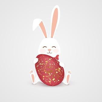 Feliz conejito de pascua con huevo rojo