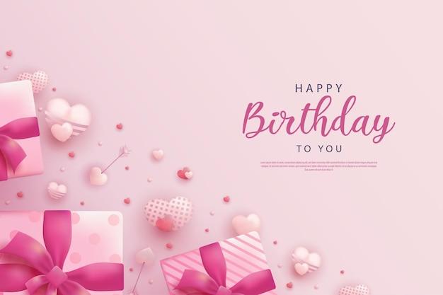 Feliz cumpleaños sobre fondo rosa y con color de globo de corazón suave