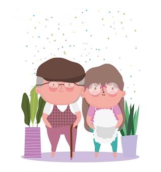 Feliz día de los abuelos. linda pareja de ancianos con plantas en maceta