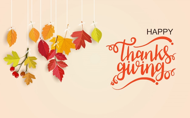 Feliz día de acción de gracias tarjeta de felicitación con letras y hojas colgantes