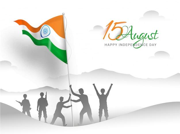Feliz día de la independencia india. soldado del ejército indio haciendo bandera alzando en la cima de la montaña