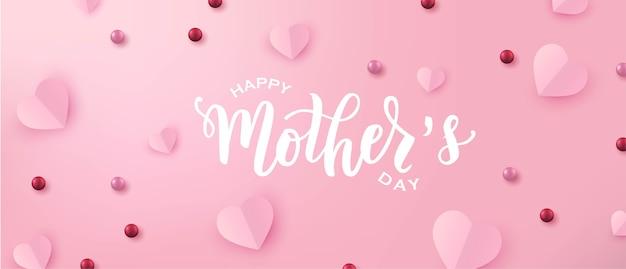 Feliz día de las madres texto de letras a mano con corazones de papel cortado