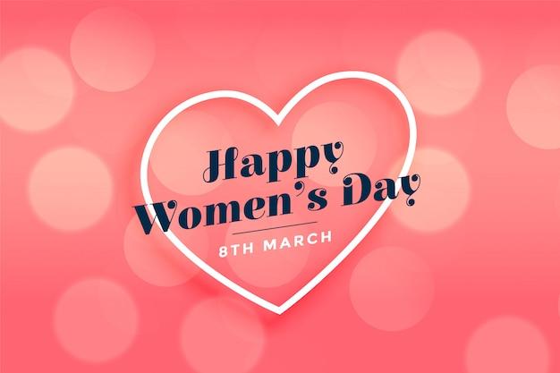 Feliz día de la mujer corazón rosa bokeh de fondo