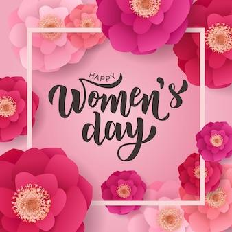 Feliz día de la mujer texto de letras a mano con hermosas flores.