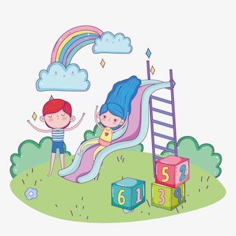 Feliz día de los niños, niñas jugando en tobogán y niño con parque de bloques