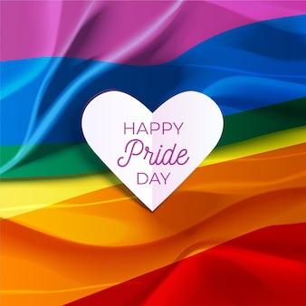 Feliz día del orgullo letras en una bandera del corazón y el arco iris