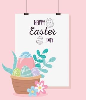 Feliz día de pascua, cesta con huevos flores hojas follaje decoración tarjeta