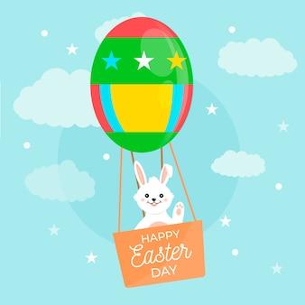 Feliz día de pascua con conejito en globo aerostático