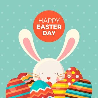Feliz día de pascua con conejito y huevos pintados