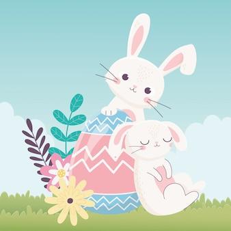 Feliz día de pascua, conejos huevo flores hojas naturaleza hierba