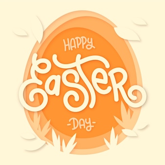 Feliz día de pascua en papel con forma de huevo y hojas