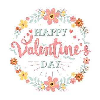 Feliz día de san valentín caligrafía manuscrita con borde de flores