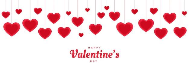 Feliz día de san valentín colgando banner de corazones decorativos