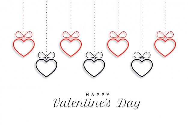 Feliz día de san valentín colgando corazones de fondo