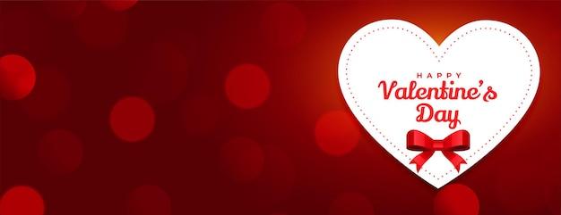 Feliz día de san valentín diseño de banner rojo bokeh