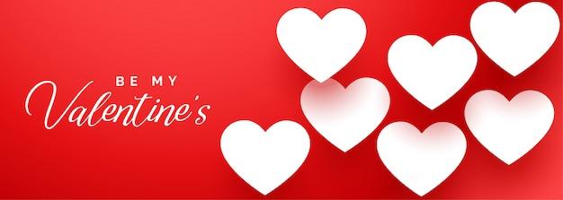 Feliz día de san valentín elegante bandera roja con corazones blancos