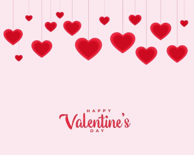 Feliz día de san valentín fondo de amor con corazones colgantes