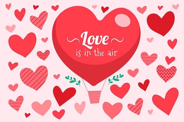 Feliz día de san valentín fondo con corazón de globo de aire caliente